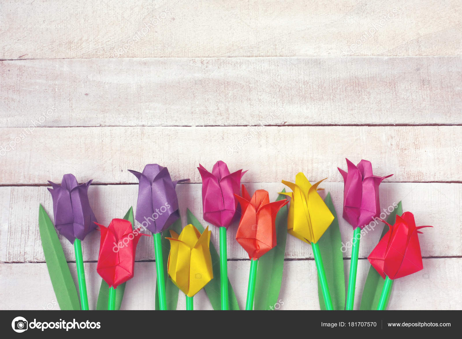 Colorful Tulips Origami Flowers Border On White Wooden Table Stock