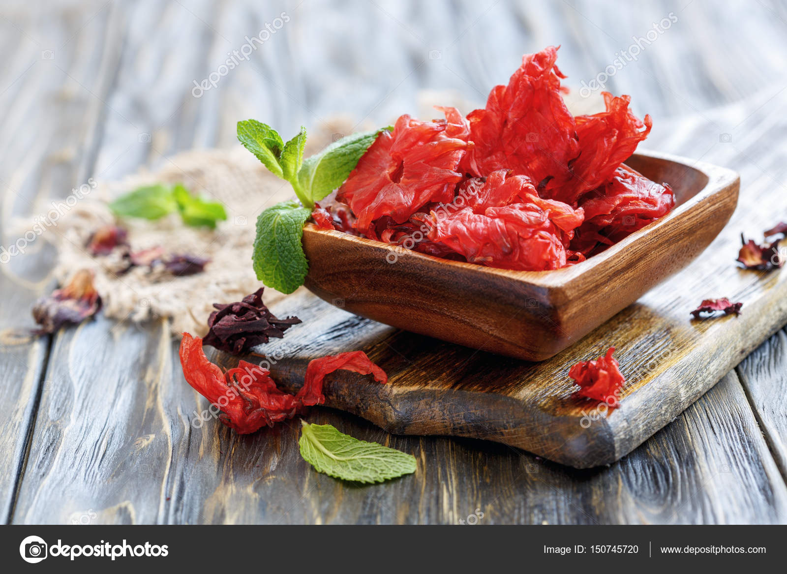 Dried Hibiscus Flowers In A Wooden Bowl Stock Photo Sriba3
