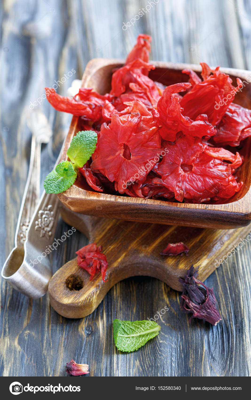 Dried hibiscus flowers in a wooden bowl stock photo sriba3 dried hibiscus flowers in a wooden bowl stock photo izmirmasajfo