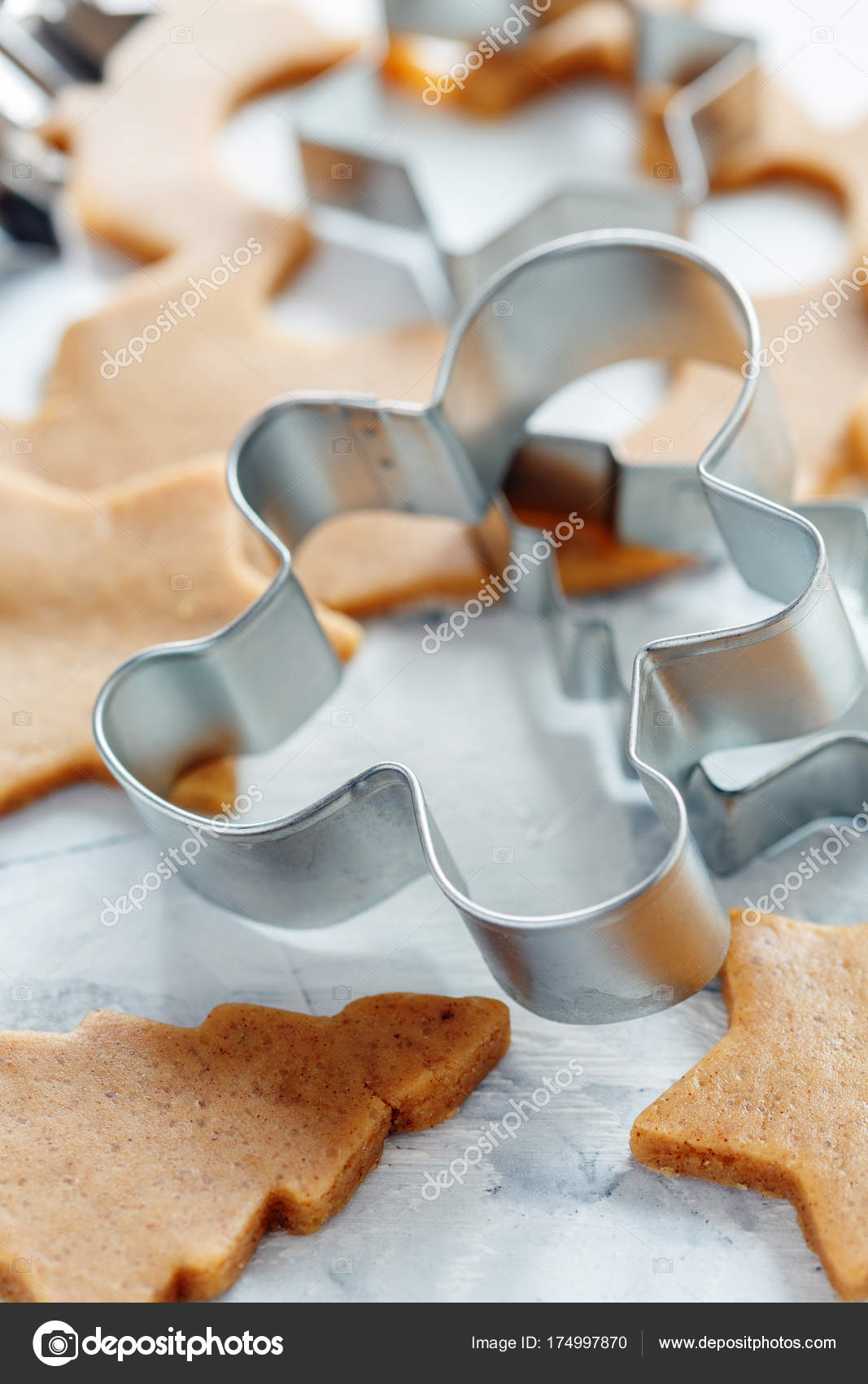 cutters for christmas cookies and the dough for gingerbread on the kitchen table selective focus photo by sriba3 - Metal Christmas Cookie Cutters