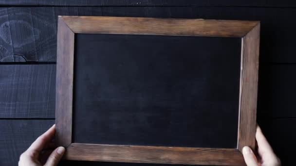 Old fashioned writing slate at wooden table