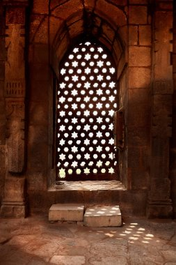 Stone balcony with ancient mosaic window in the Qutub Minar comp
