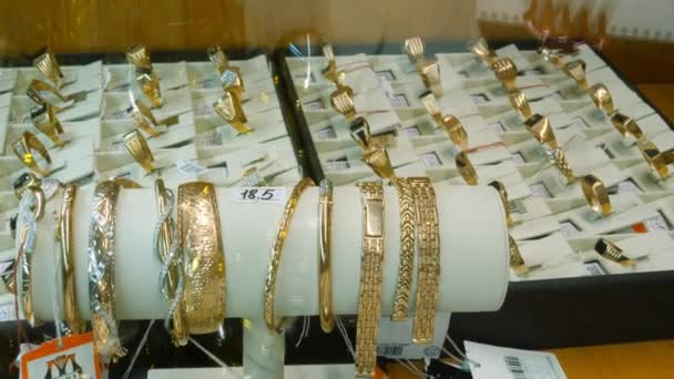 Jewelry for sale. Golden rings with diamonds and other gemstones jewelry for women in the gold market