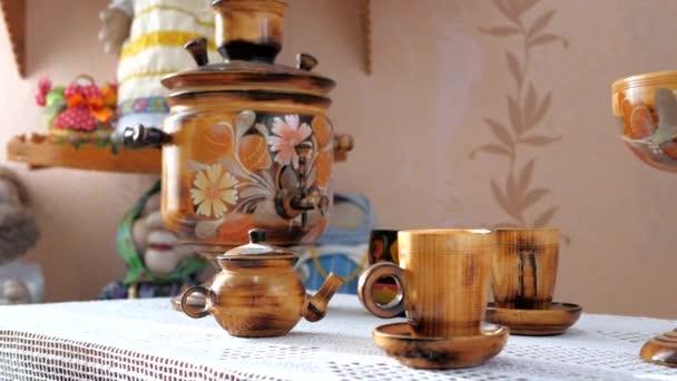 Samovar, wooden utensils.