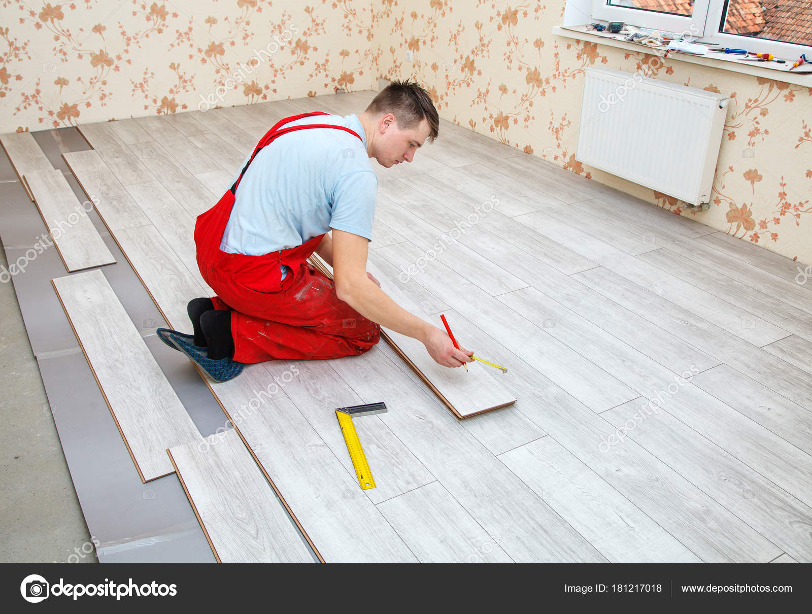 Handyman Laying Down Laminate Flooring Boards Stock Photo