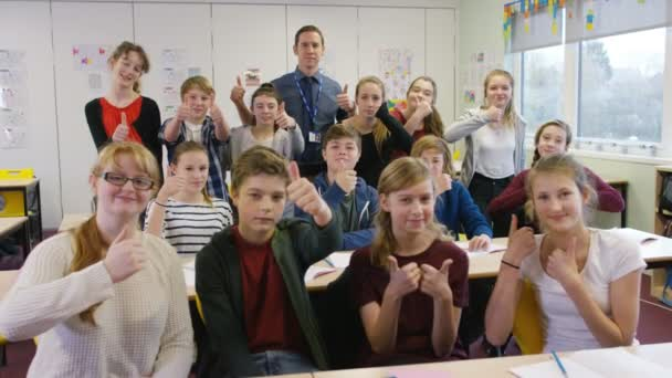 students giving thumbs up in classroom