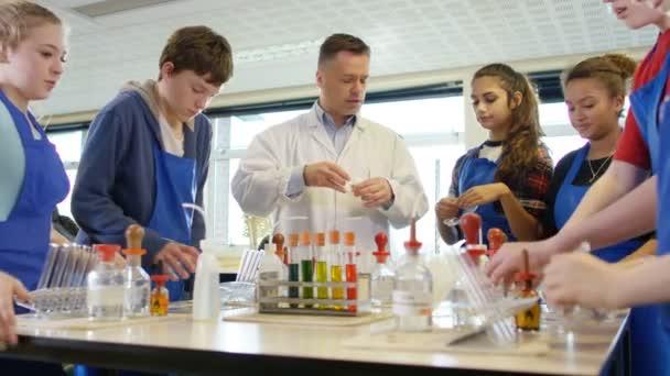 Teacher teaching students in  science class