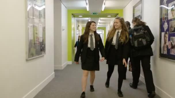 students walking through corridor