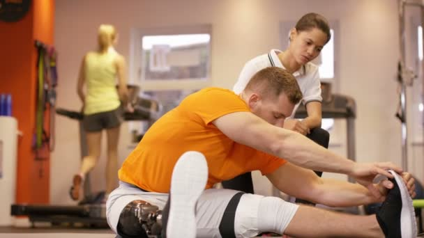 trainer working out with personal trainer