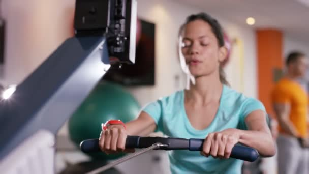 Woman working out on rowing machine