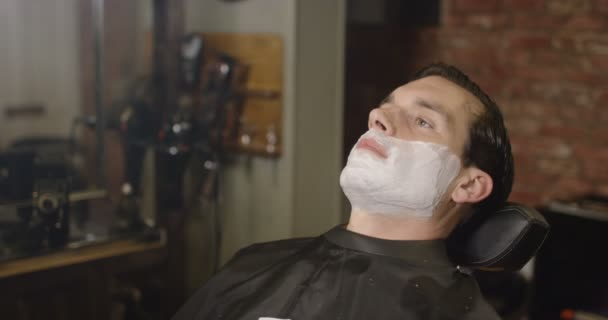 man prepared for a traditional shave