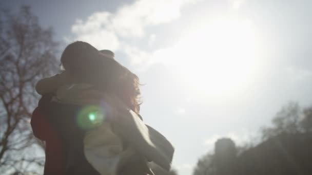 couple meet and embrace outdoors