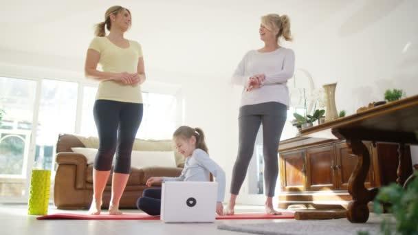 family doing yoga