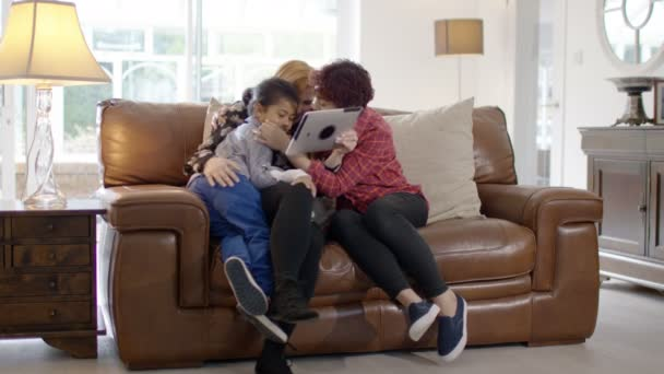 female couple at home with son