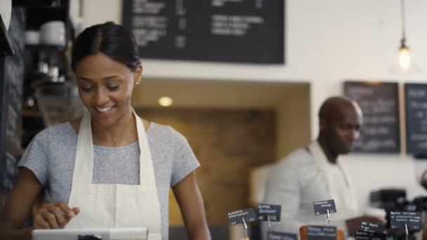 worker serving a customer in shop