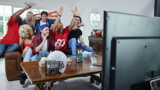 friends watching American football game