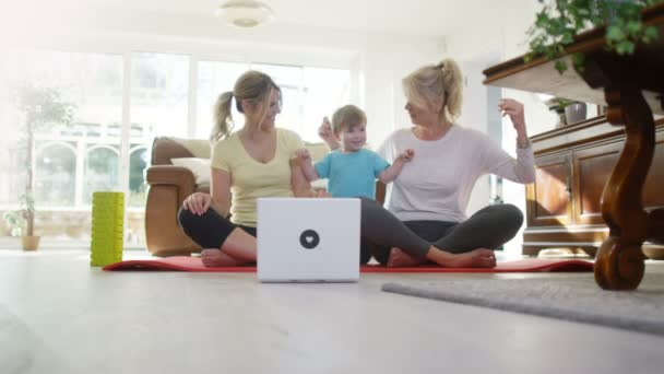 family follow a yoga