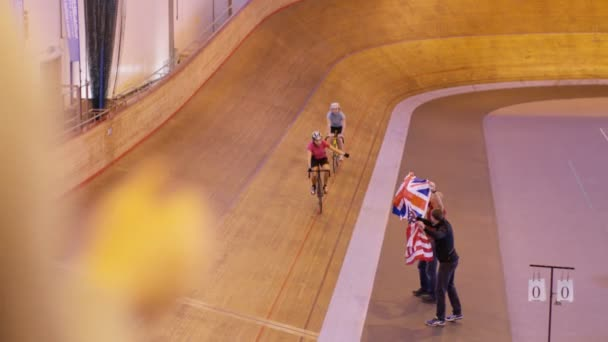 cyclists on racing track in velodrome