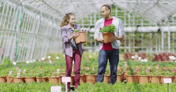 couple looking at plants