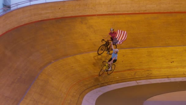 cyclists on racing track with flag