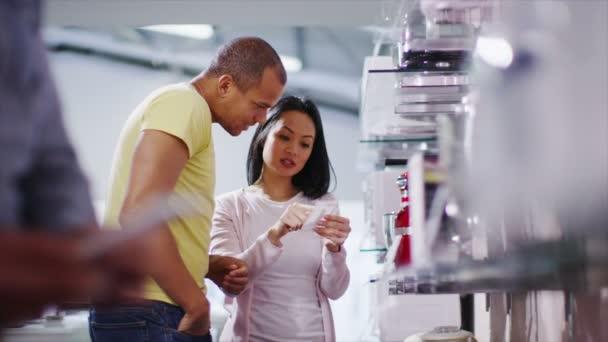 Couple shopping kitchen appliances