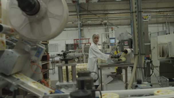 woman packing products in manufacturing facility