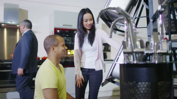 Couple shopping kitchen appliances — Stock Video © Hotelfoxtrot ...