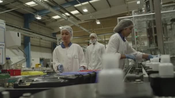 Workers on a production line