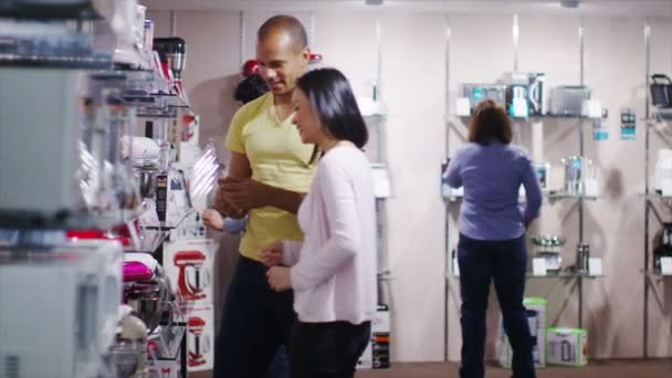 Couple shopping kitchen products