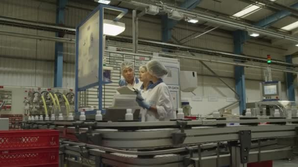 Workers operate production machinery