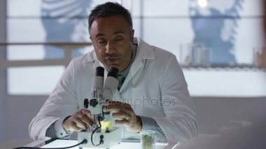 Male medical researcher working in the lab analyzing samples