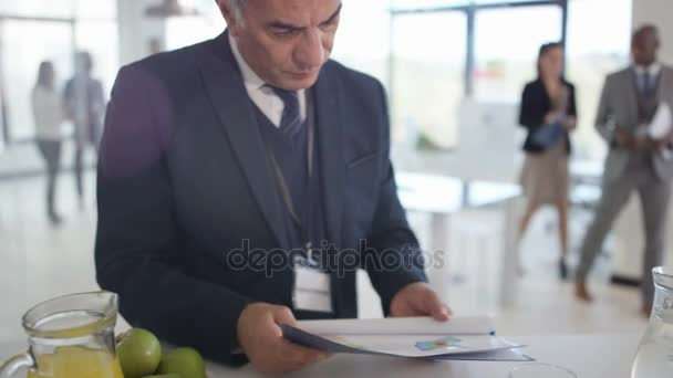 4K Corporate managers at a business seminar, looking at paperwork and discussing