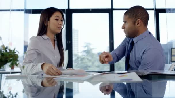 4K Business manager reprimanding female member of staff in office meeting