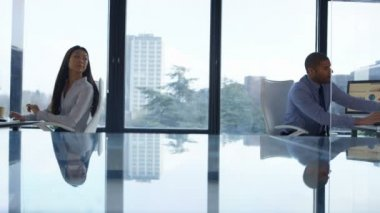 4K Business man and woman working at their desks and also discussing paperwork