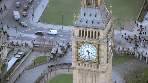 4K Aerial view above famous landmark Big Ben and Houses of Parliament in Londons city of Westminster, situated by the side of the river Thames
