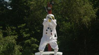 4K Hooligan astronaut smashing car windshield with a baseball bat.