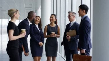 4K Attractive mixed ethnicity business team talking in large modern office