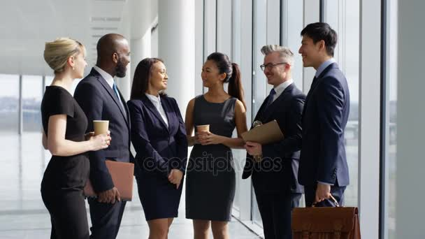 4K Portrait of smiling mixed ethnicity business team in large modern office