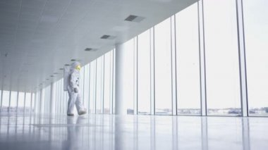 4K Astronaut returned to earth exploring an empty building
