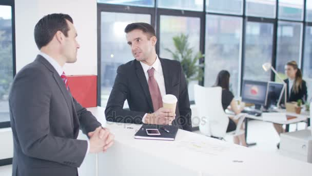 4K two businessmen in discussion in modern city office