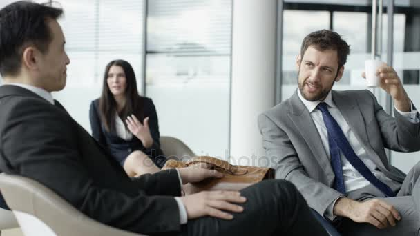 4K Business people chatting together in lobby of modern office building