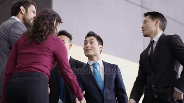 Business teams greeting each other shaking hands modern office 4k business teams greeting each other and shaking hands in modern office building stock footage m4hsunfo