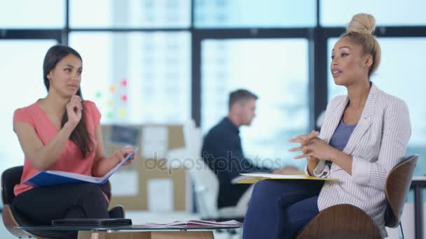 4K Cheerful businesswomen working together in modern office and discussing business plan
