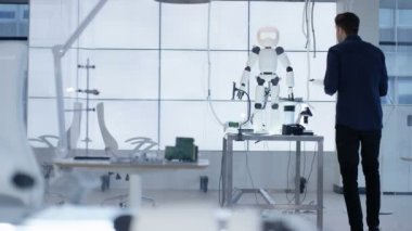 4K Technical engineer working on construction of automated robot in modern lab
