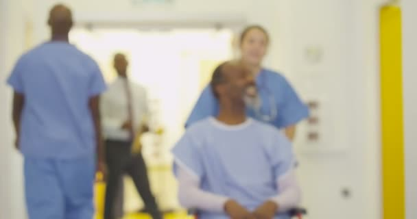 4K Friendly medical workers taking care of patients in modern hospital.