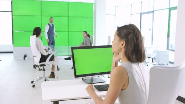 4K Business team working in modern office with green screen