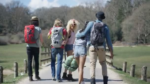 4K Hipster friends in the countryside going to festival or on a camping trip