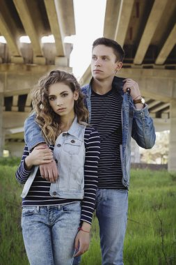 Young beautiful fashion couple wearing jeans clothes in daylight