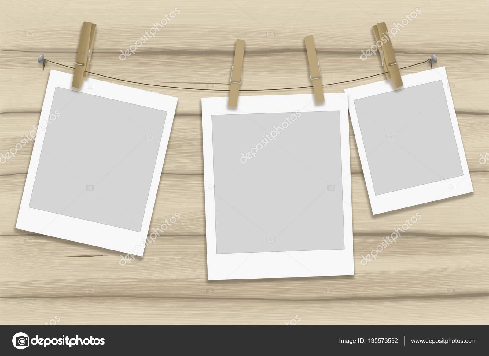 Abbildung Fotorahmen an einem Seil mit hölzernen Wäscheklammern ...