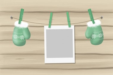 illustration green mittens and photo frame on a rope with clothespins